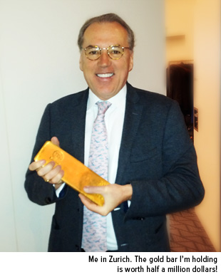 Frank Holmes in Zurich holding a gold bar