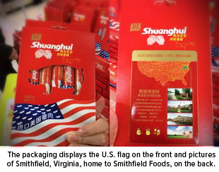 The packaging displays the U.S. flag on the front and pictures of Smithfield, Virginia, home to Smithfield Foods, on the back