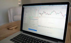 Laptop screen displaying stocks